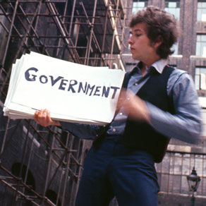 "Dylan, while filming the music video for the song ""Subterranean Homesick Blues"""