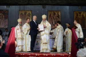 Current PSD President, Liviu Dragnea, is awarded by Patriarch Daniel